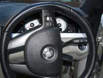 Turn steering wheel 90* to access the airbag metal clip
