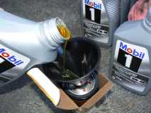 Adding oil to the new oil filter