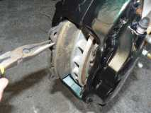 Removing the brake pads, and brake pad carrier