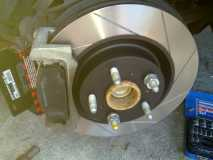New Rotor, Brake Caliper Mounting Assembly and Brake Pads Fitted