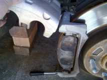 Swinging the Caliper Upwards to access the Brake Pads